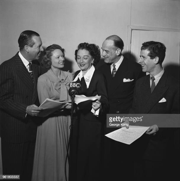 English actress Anna Neagle guest stars on a new series of the BBC comedy radio show 'Hi Gang' February 1949 From left to right Ben Lyon Neagle Bebe...