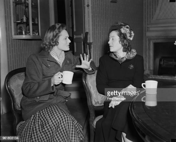 English actress Anna Neagle has tea with Odette Churchill later Hallowes at Elstree studios where she is playing the part of the famous wartime...