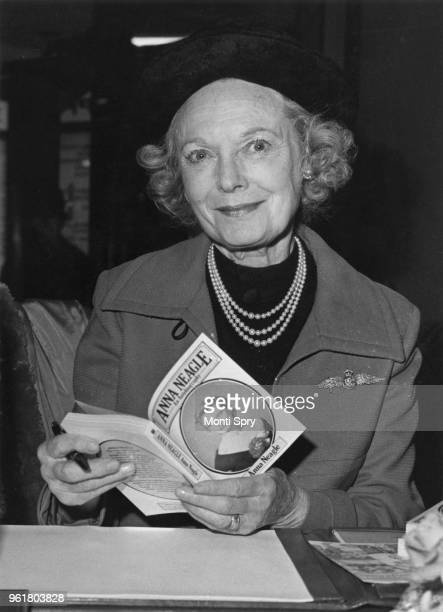 English actress Anna Neagle signs copies of her autobiography at Barkers of Kensington London 21st November 1979