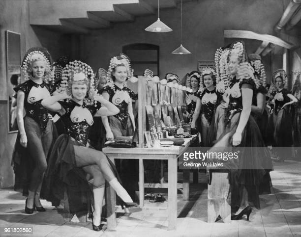 English actress Anna Neagle stars as a chorus girl in the film 'Limelight' aka 'Street Singer's Serenade' or 'Backstage' during filming at the London...