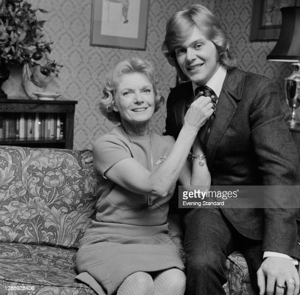 English actress Anna Neagle with Australian actor and singer John Farnham, her co-star in the stage musical 'Charlie Girl', UK, 1971.