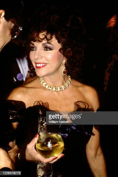 English actress, author, and columnist Joan Collins poses during the Women's Wear Daily party circa September, 1987 at Elizabeth Taylor's estate in...