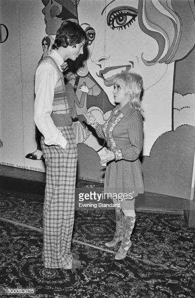 English actress Barbara Windsor chats with American actor and singer Tommy Tune at a press reception for the musical comedy film 'The Boy Friend' at...