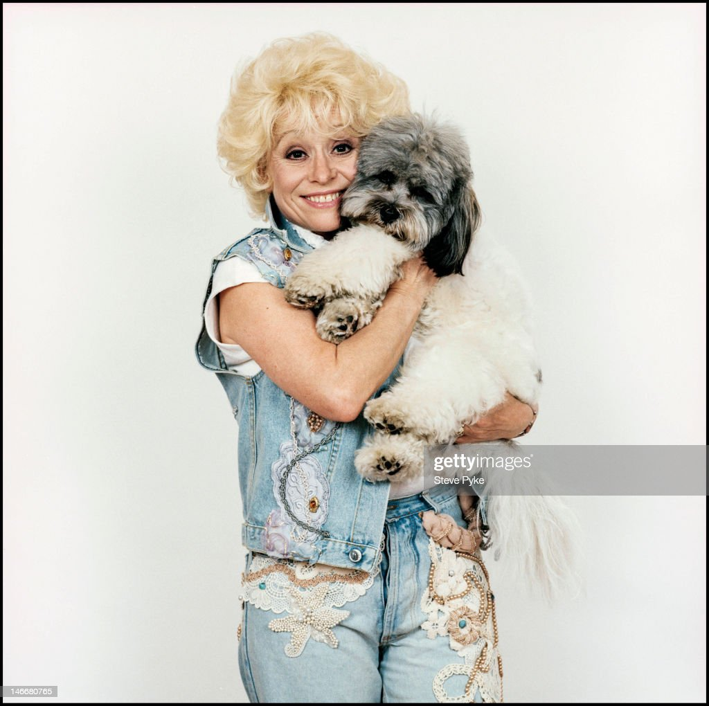 English actress Barbara Windsor with a dog, 5th June 1990.
