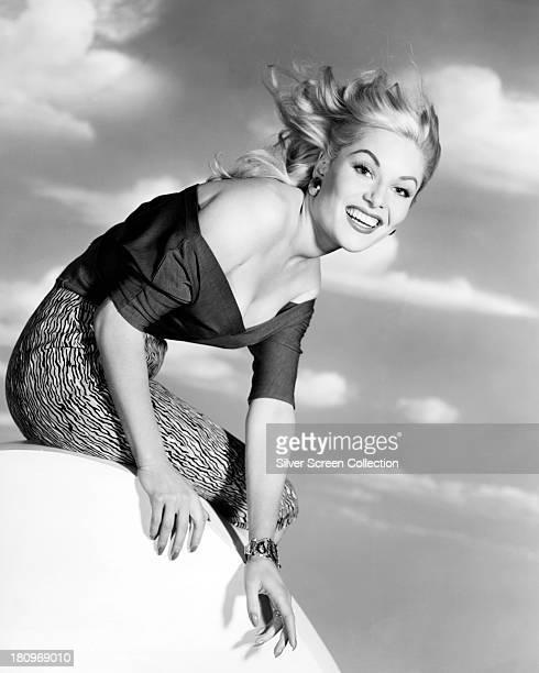 English actress Belinda Lee wearing an offthe shoulder top circa 1955
