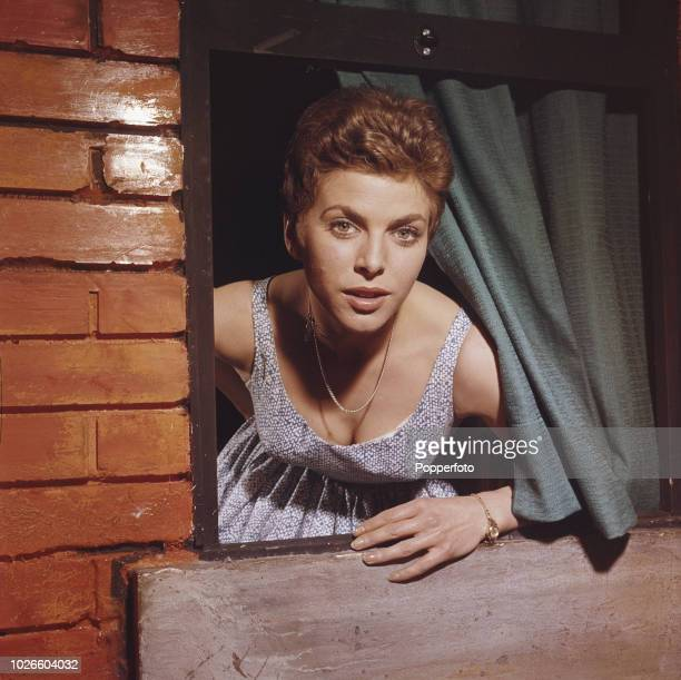 English actress Billie Whitelaw pictured looking through the window of a stage set in England in 1961. Billie Whitelaw would go on to be nominated...