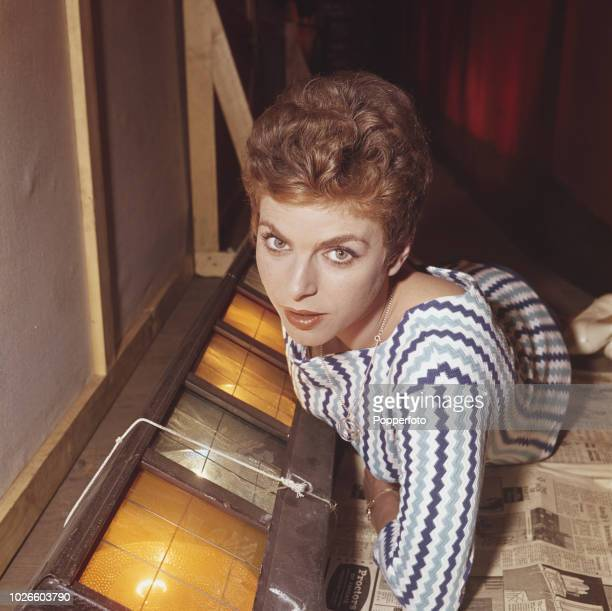 English actress Billie Whitelaw pictured lying down beside lights and scenery on a stage in England in 1961. Billie Whitelaw would go on to be...
