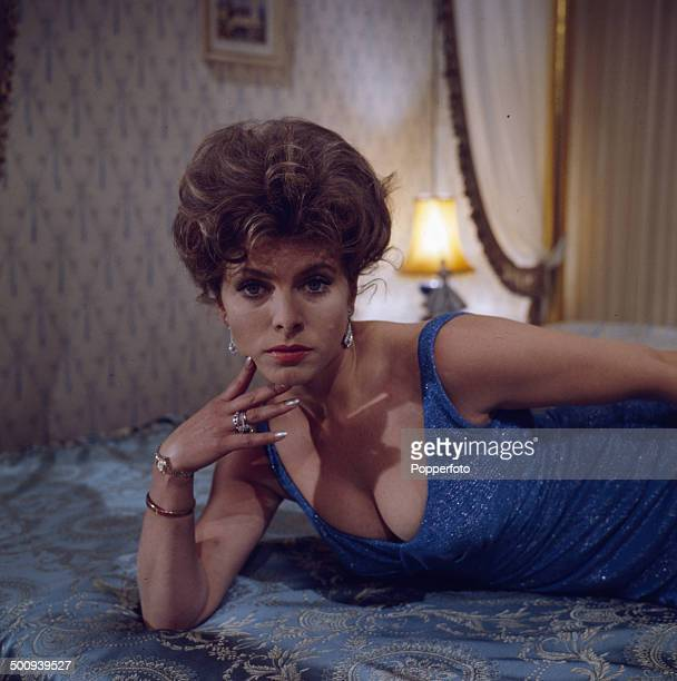 English actress Billie Whitelaw pictured lying on a bed on the set of the television drama 'Ballad Of Queenie Swann' in 1966.