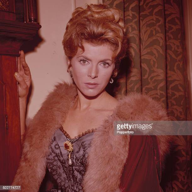 English actress Billie Whitelaw posed wearing a fur lined coat and corset in 1963.