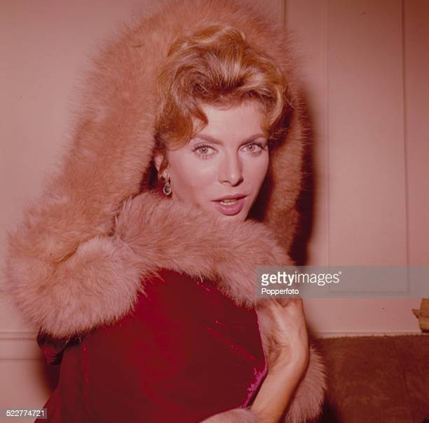 English actress Billie Whitelaw posed wearing a fur lined red coat in 1963