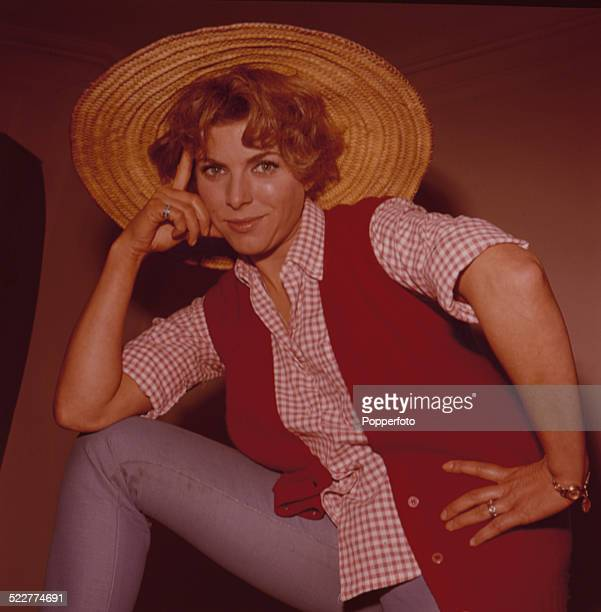 English actress Billie Whitelaw posed wearing a gingham shirt, red waistcoat and straw hat in 1963.