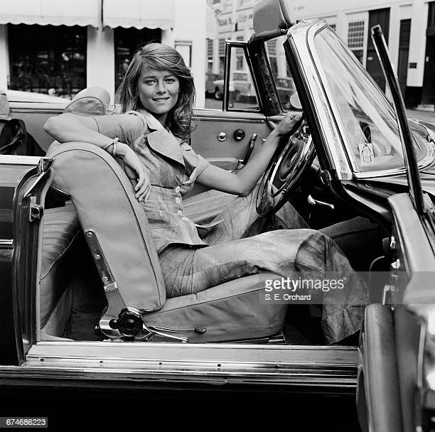 English actress Charlotte Rampling at the wheel of a convertible UK 27th August 1971