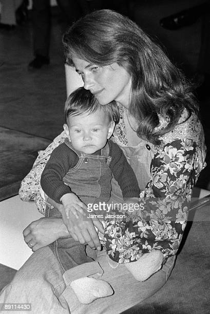 English actress Charlotte Rampling with her 8 monthold baby son Barnaby at Heathrow Airport London 11th May 1973 Rampling her son and her husband...