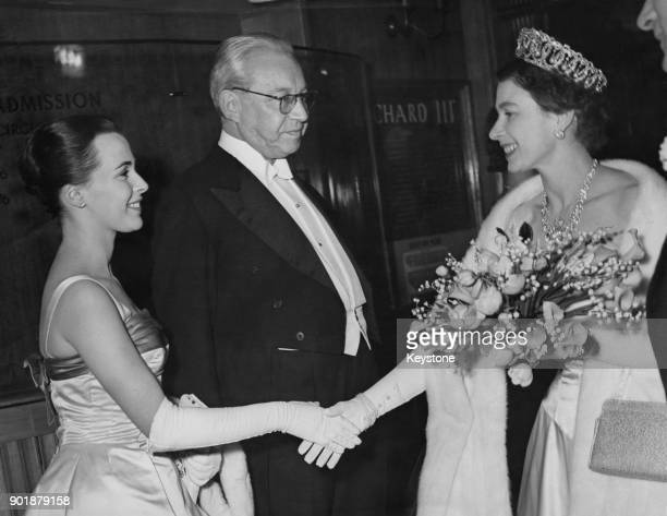 English actress Claire Bloom and producer Sir Alexander Korda are presented to Queen Elizabeth II after the premiere of the film 'Richard III' at the...