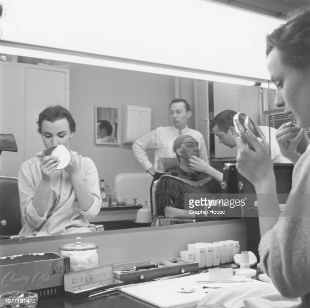 English actress Claire Bloom applies her makeup in the dressing room 1st March 1956