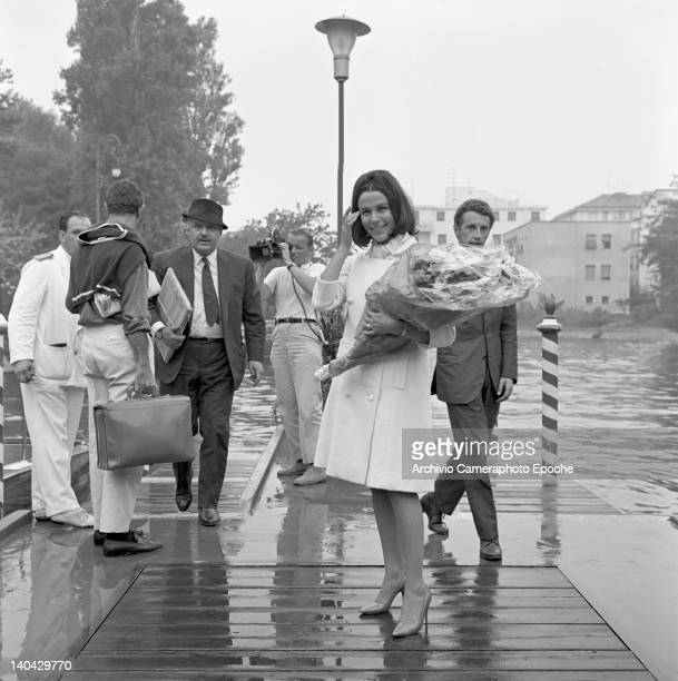 English actress Claire Bloom holding a bouquet Lido Venice 1960s