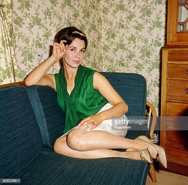 English actress Claire Bloom posed sitting on a sofa in 1964