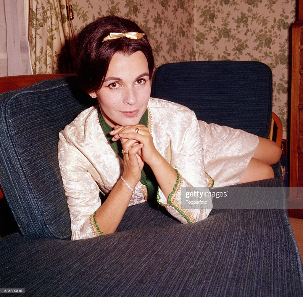 English actress Claire Bloom posed sitting on a sofa in 1964.