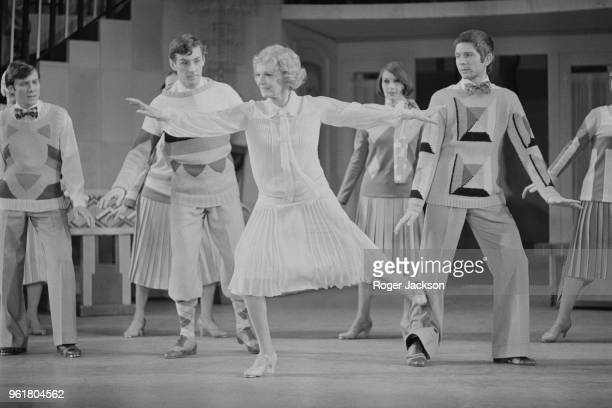 English actress Dame Anna Neagle rehearses a dance routine with the chorus of 'No No Nanette' at the Drury Lane Theatre in London 10th May 1973