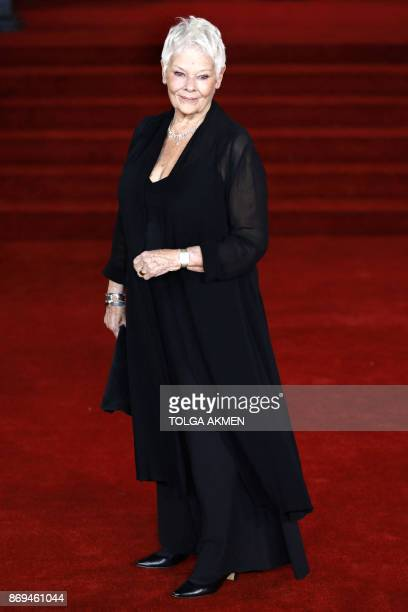English actress Dame Judi Dench poses upon arrival to attend the world premiere of the film 'Murder on the Orient Express' at the Royal Albert Hall...