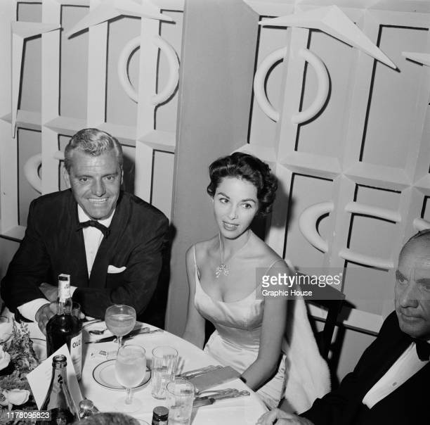 English actress Dana Wynter and her husband attorney Greg Bautzer attend the premiere afterparty for the film 'Island in the Sun' USA 1957