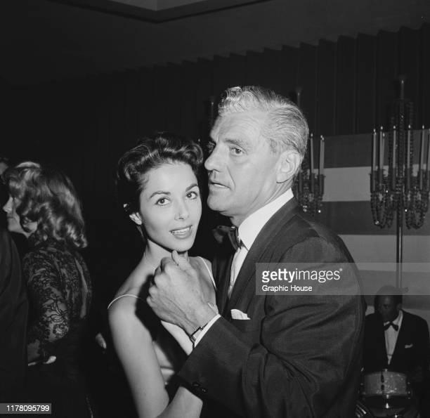 English actress Dana Wynter dancing with her husband attorney Greg Bautzer USA 1957