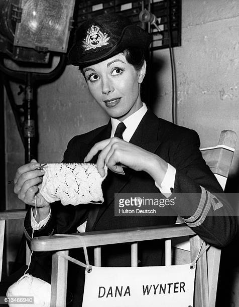 English actress Dana Wynter knitting on the film set of Sink the Bismarck in which she plays a WREN intelligence officer 1959