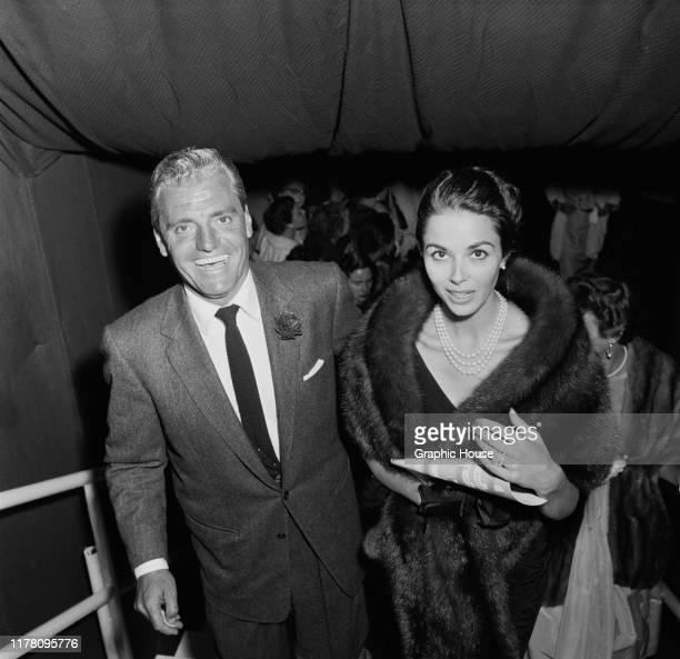 English actress Dana Wynter with her husband attorney Greg Bautzer at the Shipstads Johnson Ice Follies USA circa 1957