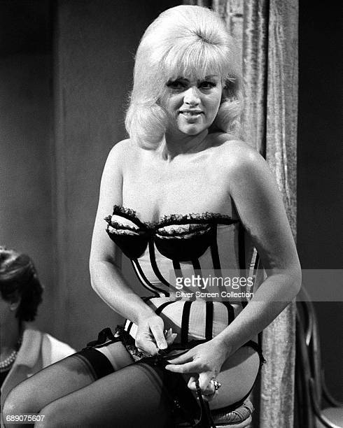 English actress Diana Dors as a stripper in 'The Peeling of Sweet P Lawrence' an episode of the television series 'The Inquisitors' 1968
