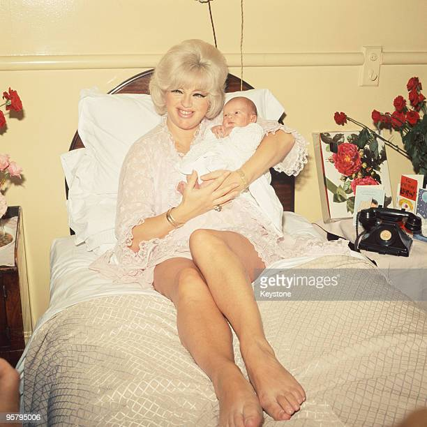 English actress Diana Dors at a London clinic with her baby son Jason, 15th September 1969. Jason's father is the actor Alan Lake.