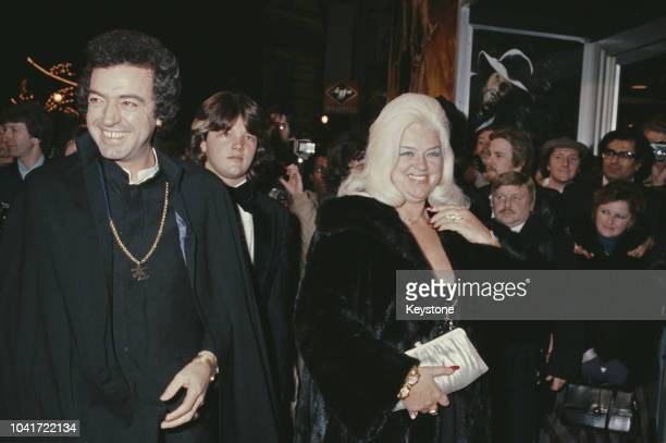 English actress Diana Dors , her husband Alan Lake and their son Jason attend a screening of the television film 'Freedom Road', London, UK, 1980.