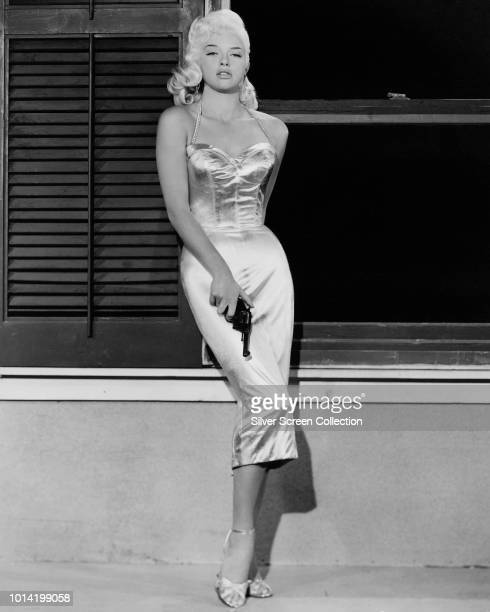 English actress Diana Dors in a publicity still for the film 'The Unholy Wife', 1957.