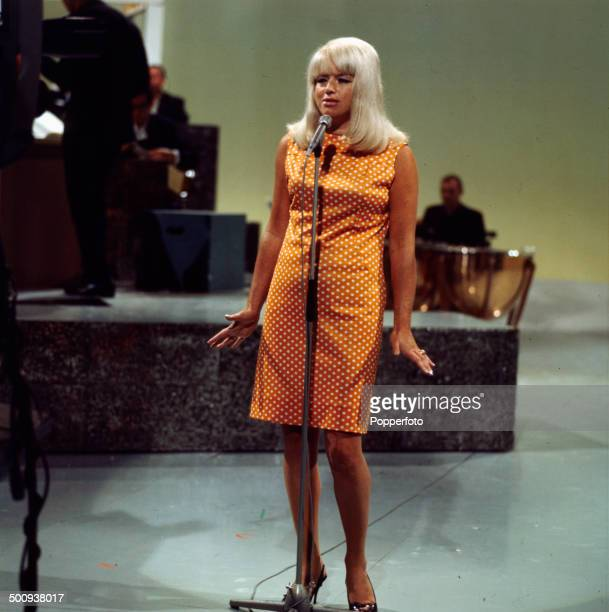 English actress Diana Dors pictured performing on the television series 'The Dickie Valentine Show' in 1966.