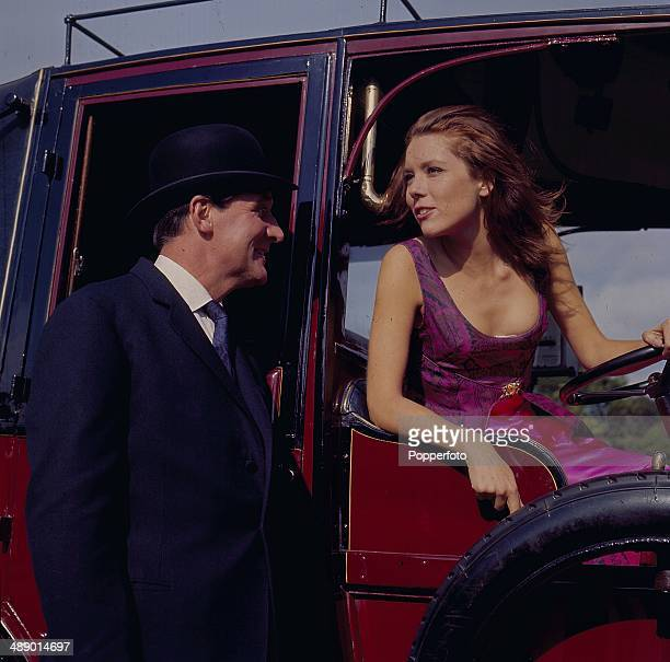 English actress Diana Rigg and English actor Patrick Macnee as 'Emma Peel' and 'John Steed' in a vintage car on the set of the television series 'The...