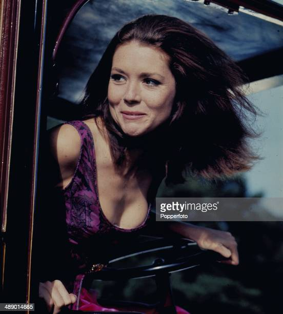 1967 English actress Diana Rigg as 'Emma Peel' posed in a vintage car on the set of the television series 'The Avengers' in 1967