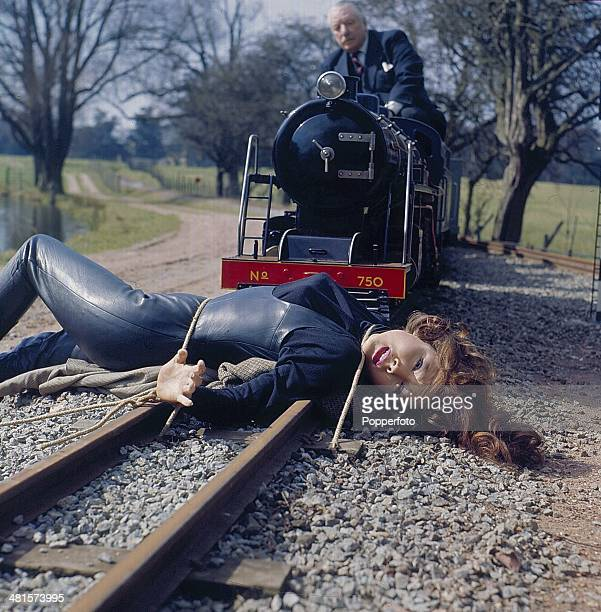 1968 English actress Diana Rigg as 'Emma Peel' is tied to a railway track as a miniature train advances on her in a scene from the television series...