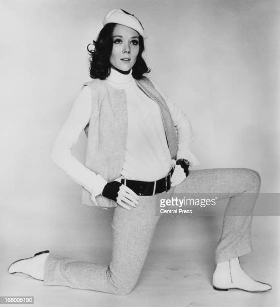 English actress Diana Rigg models a wool trouser suit called 'Blackboard', designed by John Bates for her role in television series 'The Avengers',...