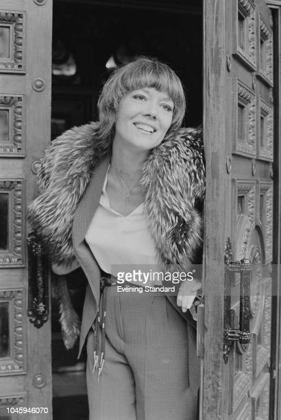 English actress Diana Rigg opening a a door, UK, 19th March 1969.