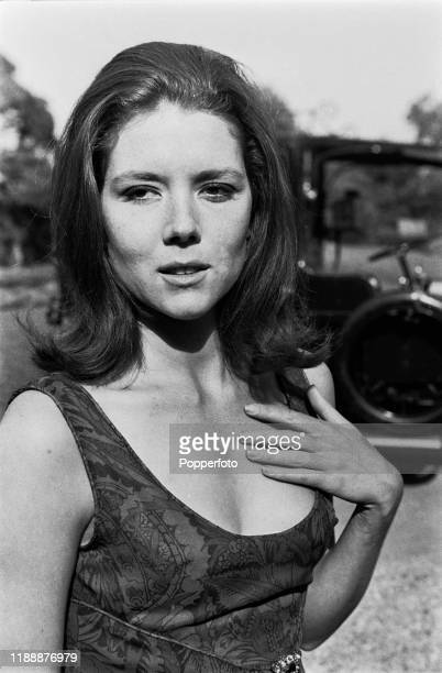 English actress Diana Rigg posed in character as 'Emma Peel' during shooting of the ABC Weekend Television series 'The Avengers' at Beaulieu in...