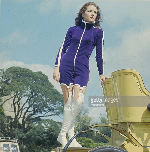 English actress Diana Rigg posed on a vintage car on location during filming of the television series 'The Avengers' at Beaulieu, Hampshire in...