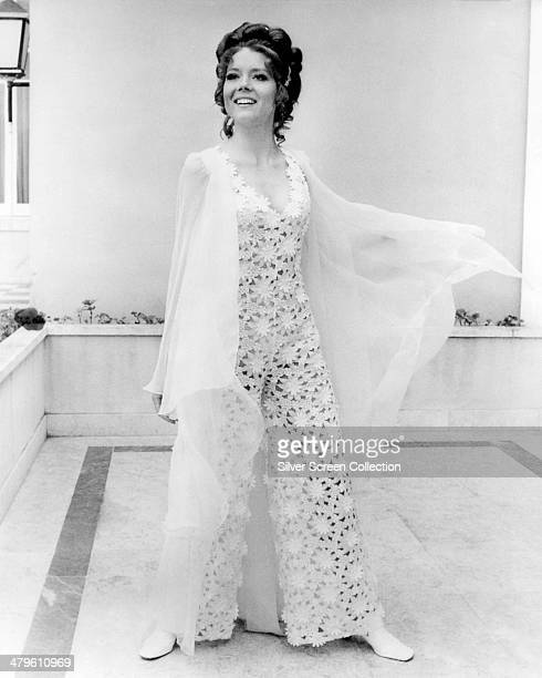 English actress Diana Rigg wearing a lace outfit in a promotional portrait for 'On Her Majesty's Secret Service' directed by Peter R Hunt 1969 Rigg...