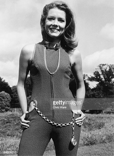 English actress Diana Rigg wearing a violet-coloured catsuit with cut-away hips, one of her costumes from the new series of 'The Avengers', 5th...