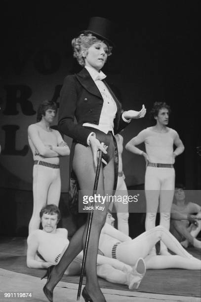 English actress Diana Rigg wearing top hat and tails during rehearsals for the play 'Jumpers' at the Old Vic Theatre London 2nd February 1973
