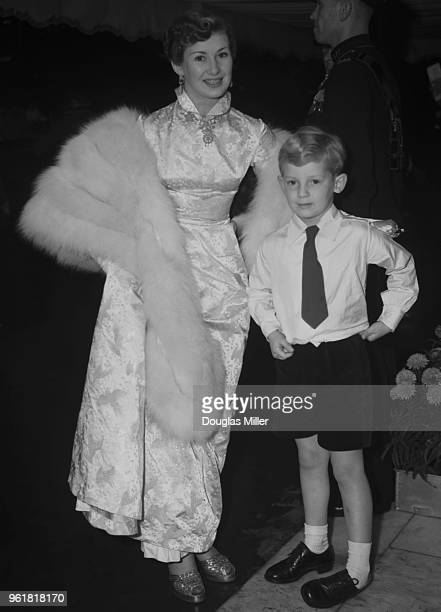 English actress Dinah Sheridan and her son Jeremy Hanley arrive at the Odeon Leicester Square in London for the Royal Film Performance of 'Where No...