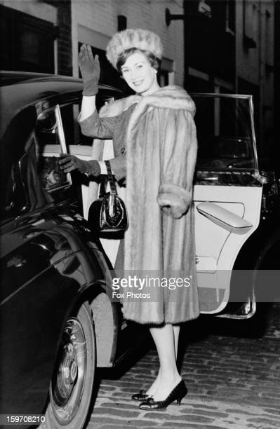 English actress Dinah Sheridan leaves her home in Belgravia London for a holiday in Barbados 12th February 1964 Whilst there she plans to make an...