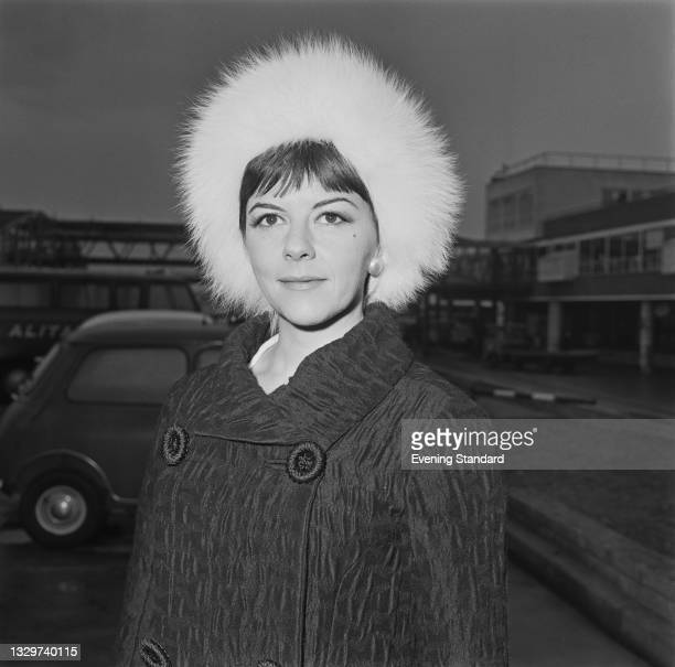 English actress Dorothy Tutin of the Royal Shakespeare Company at London Airport, UK, 18th November 1964. She is returning from Rome after performing...