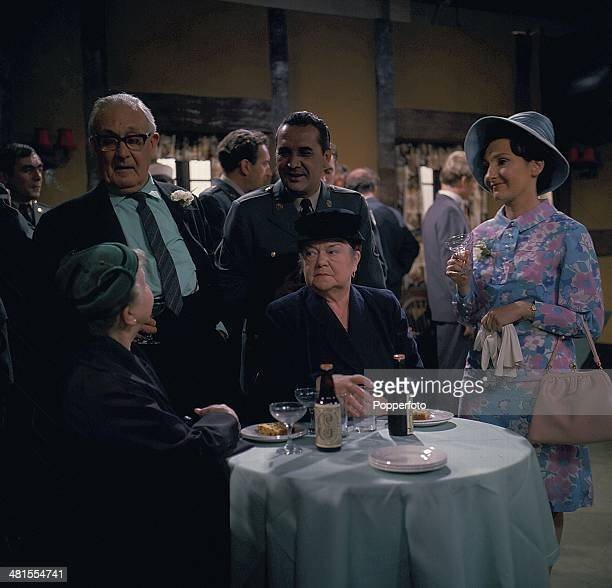1968 English actress Eileen Derbyshire and Violet Carson pictured in character as Emily Bishop and Ena Sharples in a wedding scene from the long...