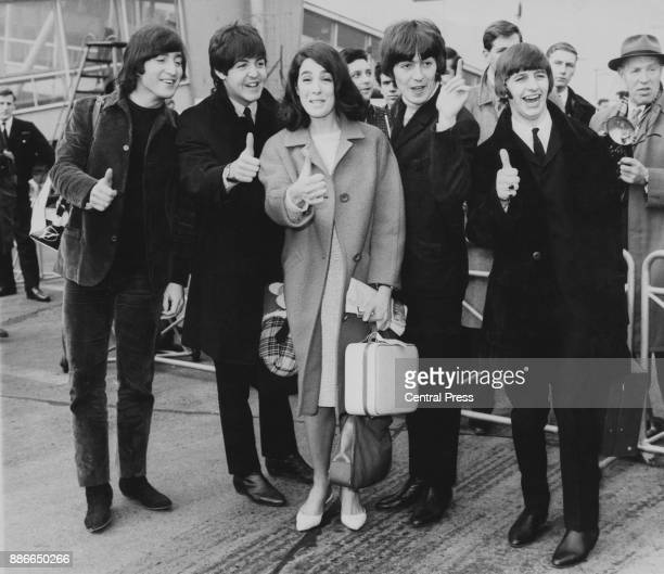 English actress Eleanor Bron poses with British rock group the Beatles John Lennon Paul McCartney George Harrison and Ringo Starr at London Airport...