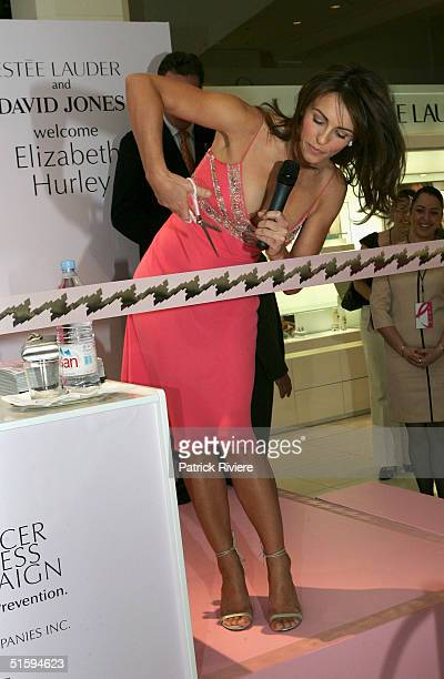 English actress Elizabeth Hurley cuts the ribbon to officialy open an Estee Lauder new stand at the David Jones Stores October 28 2004 in Sydney...