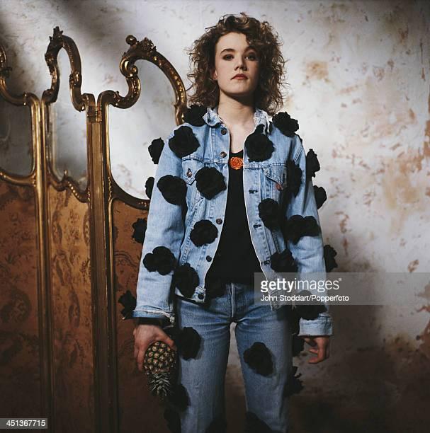 English actress Emily Lloyd holding a pineapple circa 1993